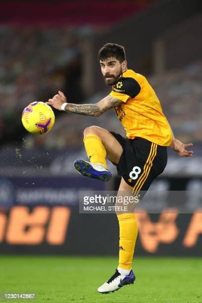 Wolverhampton Wanderers' Portuguese midfielder Ruben Neves controls the ball during the English Premier League football match between Wolverhampton...