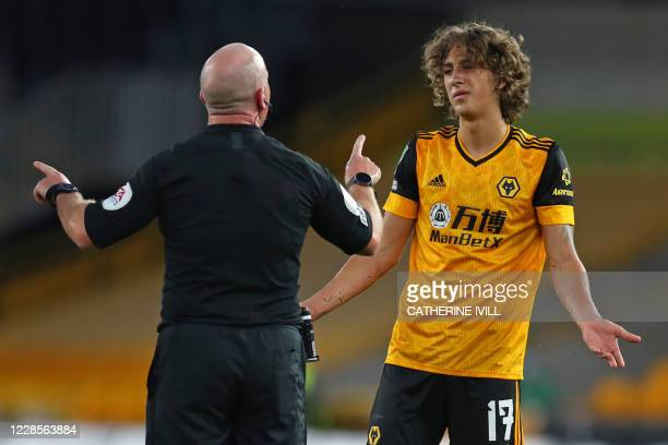 Wolverhampton Wanderers' Portuguese striker Fabio Silva reacts to referee Simon Hooper during the English League Cup second round football match...