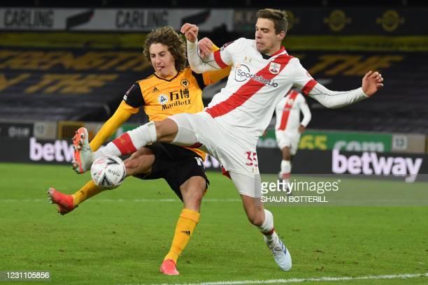 Wolverhampton Wanderers' Portuguese striker Fabio Silva vies with Southampton's Polish defender Jan Bednarek during the English FA Cup fifth round...