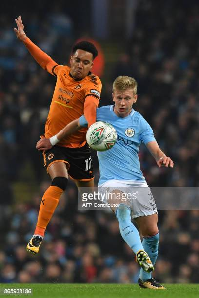 Wolverhampton Wanderers' Portuguese striker Helder Costa vies with Manchester City's Ukrainian midfielder Oleksandr Zinchenko during the English...