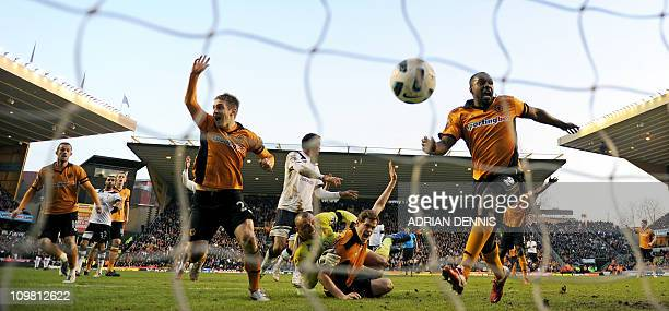 Wolverhampton Wanderers' Richard Stearman watches as the ball goes toward the goal which was disallowed for a foul as he collides with Tottenham...