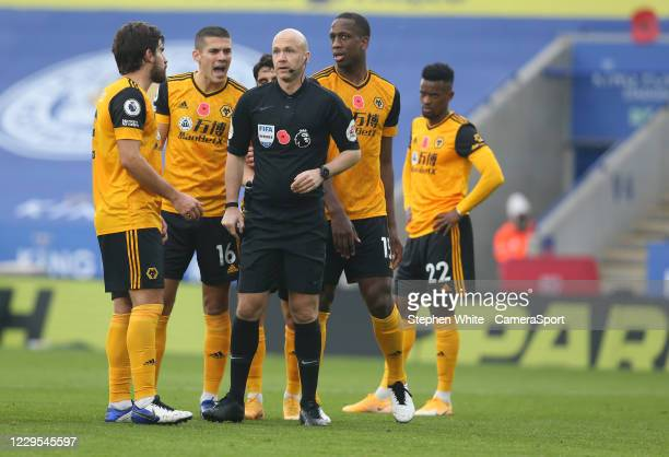 Wolverhampton Wanderers' Ruben Neves and Conor Coady argue with Referee Anthony Taylor after he awarded a penalty for handball during the Premier...