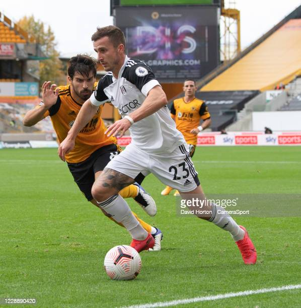 Wolverhampton Wanderers' Ruben Neves vies for possession with Fulhams Joe Bryan during the Premier League match between Wolverhampton Wanderers and...