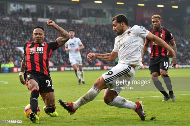 Wolverhampton Wanderers' Spanish defender Jonny Otto crosses the ball past Bournemouth's English defender Nathaniel Clyne during the English Premier...