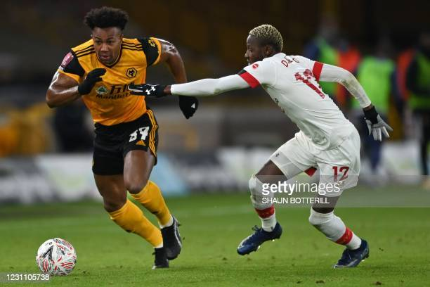 Wolverhampton Wanderers' Spanish midfielder Adama Traore vies with Southampton's Malian midfielder Moussa Djenepo during the English FA Cup fifth...