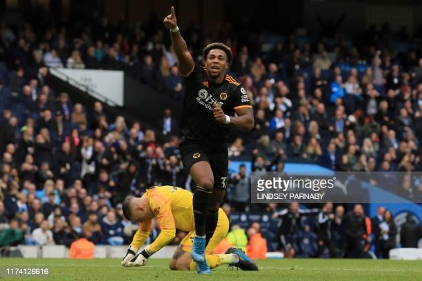 TOPSHOT Wolverhampton Wanderers' Spanish striker Adama Traore celebrates scoring the opening goal during the English Premier League football match...