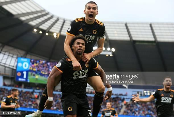 Wolverhampton Wanderers' Spanish striker Adama Traore celebrates scoring the opening goal with Wolverhampton Wanderers' English defender Conor Coady...