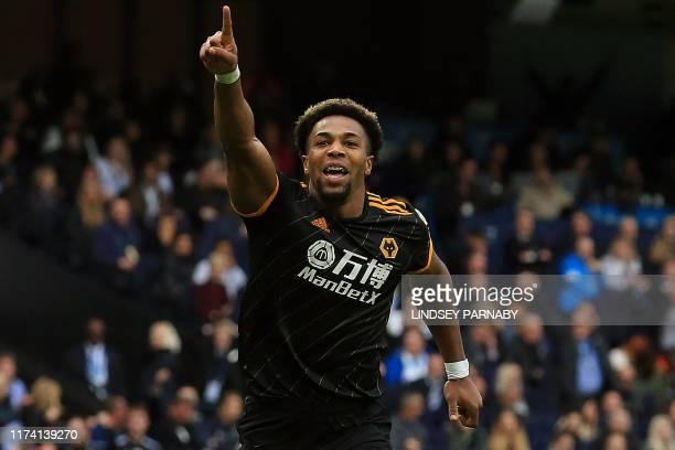 Wolverhampton Wanderers' Spanish striker Adama Traore celebrates scoring the opening goal during the English Premier League football match between...