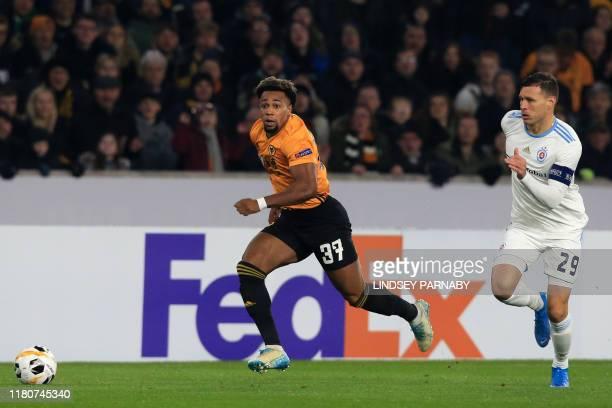 Wolverhampton Wanderers' Spanish striker Adama Traore runs away from Slovan Bratislava's Bulgarian defender Vasil Bozhikov during the UEFA Europa...