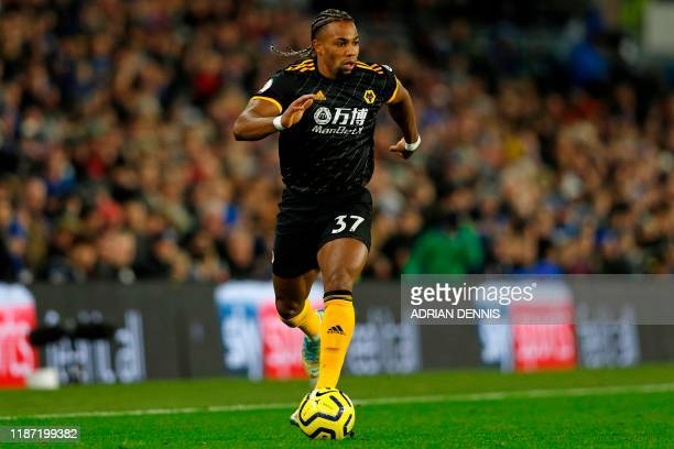 Wolverhampton Wanderers' Spanish striker Adama Traore runs with the ball during the English Premier League football match between Brighton and Hove...