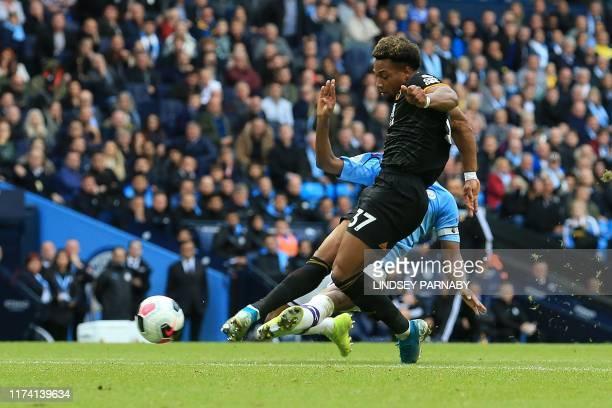 Wolverhampton Wanderers' Spanish striker Adama Traore scores his team's second goal during the English Premier League football match between...