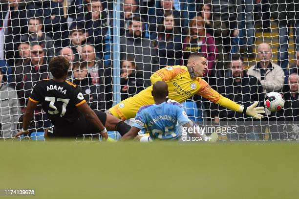 Wolverhampton Wanderers' Spanish striker Adama Traore scores his team's second goal past Manchester City's Brazilian goalkeeper Ederson during the...