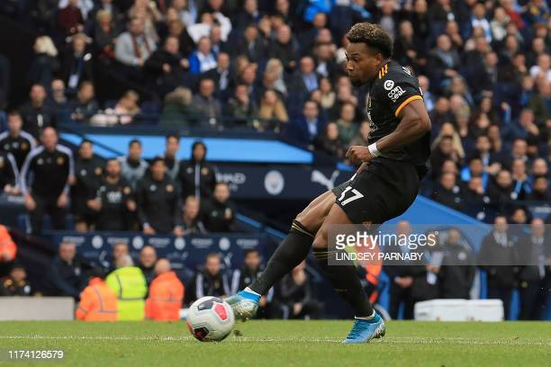 Wolverhampton Wanderers' Spanish striker Adama Traore scores the opening goal during the English Premier League football match between Manchester...
