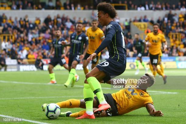 Wolverhampton Wanderers' Spanish striker Adama Traore tackles Manchester City's German midfielder Leroy Sane during the English Premier League...