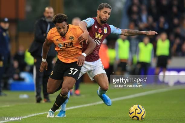 Wolverhampton Wanderers' Spanish striker Adama Traore vies with Aston Villa's Brazilian midfielder Douglas Luiz during the English Premier League...