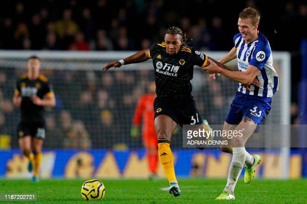 Wolverhampton Wanderers' Spanish striker Adama Traore vies with Brighton's English defender Dan Burn during the English Premier League football match...