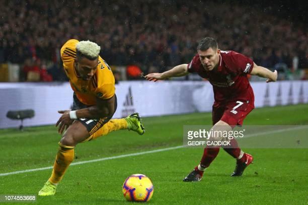 Wolverhampton Wanderers' Spanish striker Adama Traore vies with Liverpool's English midfielder James Milner during the English Premier League...