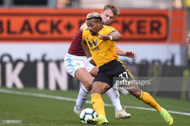 Wolverhampton Wanderers' Spanish striker Adama Traore vies with Burnley's English defender Charlie Taylor during the English Premier League football...