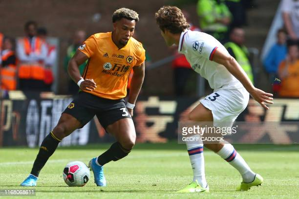 Wolverhampton Wanderers' Spanish striker Adama Traore vies with Chelsea's Spanish defender Marcos Alonso during the English Premier League football...