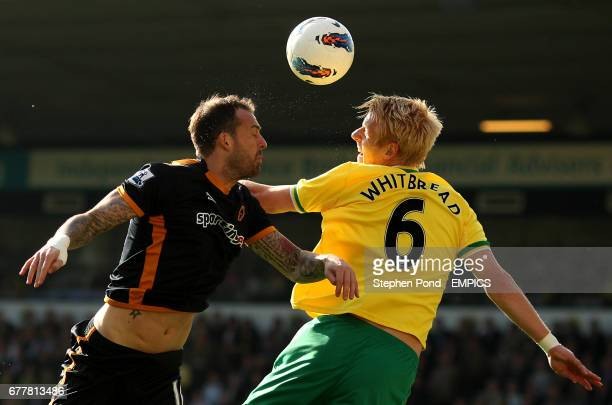 Wolverhampton Wanderers' Steven Fletcher and Norwich City's Zak Whitbread compete for the ball