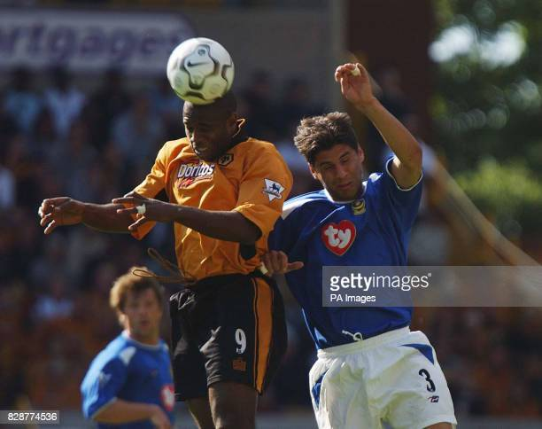 Wolverhampton Wanderers stricker Nathan Blake beats Portsmouth's Dejan Stefanovic to the ball, during their FA Premiership match at Wolves' Molineux...