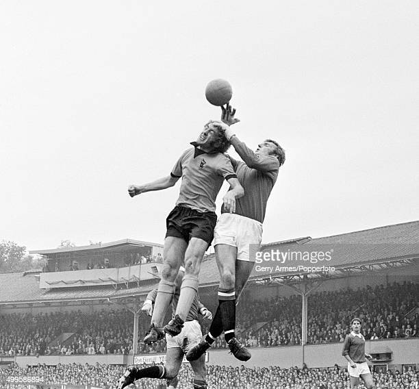 Wolverhampton Wanderers striker John Richards challenges Manchester United goakkeeper Alex Stepney during their First Division match at Molineux in...
