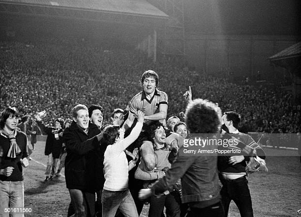 Wolverhampton Wanderers striker John Richards is carried from the pitch by Wolves fans celebrating victory over Swindon Town in the League Cup...