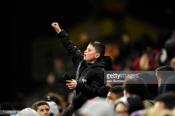 Wolverhampton Wanderers supporter celebrates after their team's second goal during the Premier League 2 match between Wolverhampton Wanderers U23 and...