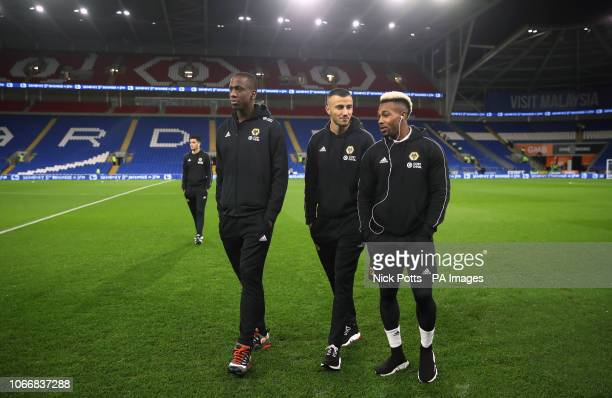 Wolverhampton Wanderers' Willy Boly Romain Saiss and Adama Traore on the pitch before the Premier League match at Cardiff City Stadium