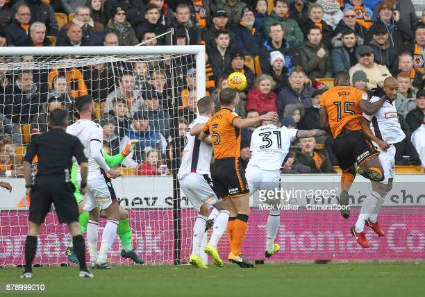 Wolverhampton Wanderers Willy Boly scores his sides first goal beating Bolton Wanderers Ben Alnwick during the Sky Bet Championship match between...