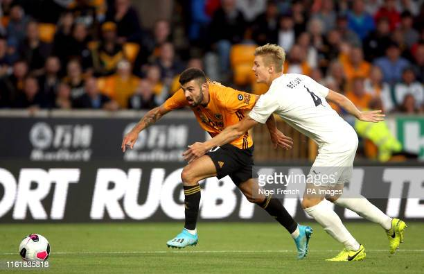Wolverhampton Wanderers's Patrick Cutrone and Pyunik's Anton Belov battle for the ball during the UEFA Europa League Third Qualifying Round Second...