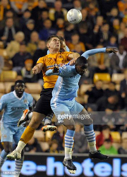 Wolverhampton Wanders's Nenad Milijas vies with Manchester City's Abdul Razak and Stefan Savic during their League Cup fourth round football match at...