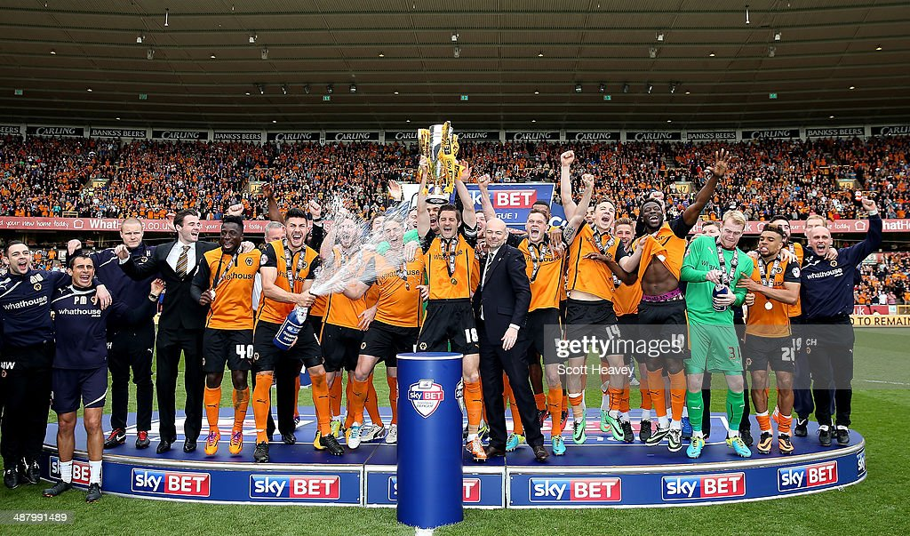 Wolves celebrate as they lift the Sky Bet League One Trophy during the Sky Bet League One match between Wolverhampton Wanderers and Carlisle United at Molineux on May 3, 2014 in Wolverhampton, England.