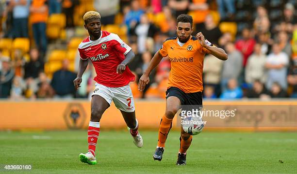 Wolves defender Scott Golbourne holds off Newport striker Medy Elito during the Capital One Cup First Round match between Wolverhampton Wanderers and...