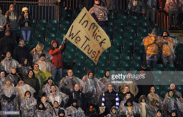 Wolves fan holds up a banner in praise of manager Mick McCarthy during the Barclays Premier League match between Wolverhampton Wanderers and...
