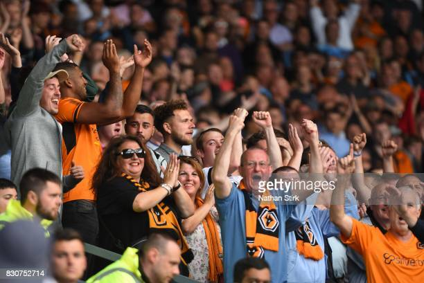 Wolves fans celebrate during the Sky Bet Championship match between Derby County and Wolverhampton at iPro Stadium on August 12 2017 in Derby England