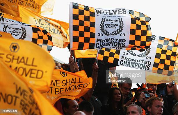 Wolves fans celebrate their promotion to the Premiership during the Coca Cola Championship match between Wolverhampton Wanderers and Doncaster Rovers...