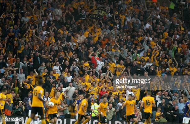 Wolves fans celebrate their second goal during the Premier League match between Wolverhampton Wanderers and Everton FC at Molineux on August 11 2018...