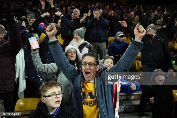 Wolves fans celebrate winning the Emirates FA Cup Third Round match between Wolverhampton Wanderers and Liverpool at Molineux on January 7 2019 in...