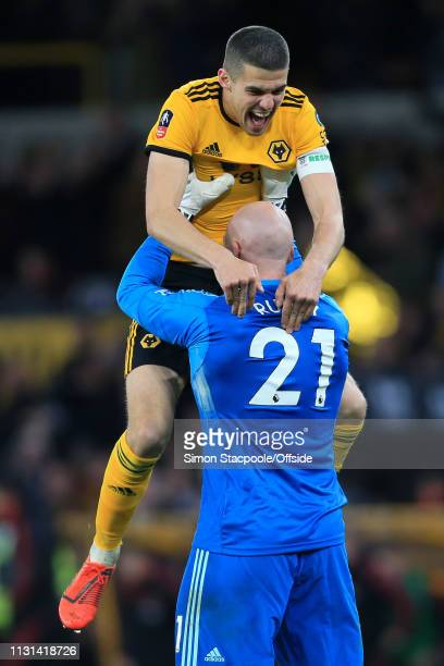 Wolves goalkeeper John Ruddy celebrates victory with teammate Conor Coady of Wolves during the FA Cup Quarter Final match between Wolverhampton...