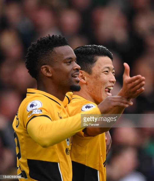Wolves goalscorer Hwang Hee-chan celebrates his goal with defender Nelson Semedo during the Premier League match between Leeds United and...
