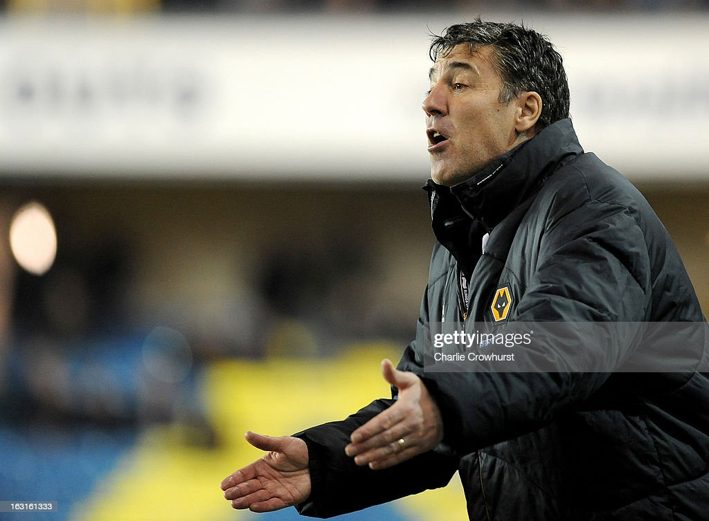 Wolves manager Dean Saunder gestures during the npower Championship match between Millwall and Wolverhampton Wanderers at The Den on March 05, 2013 in London, England,