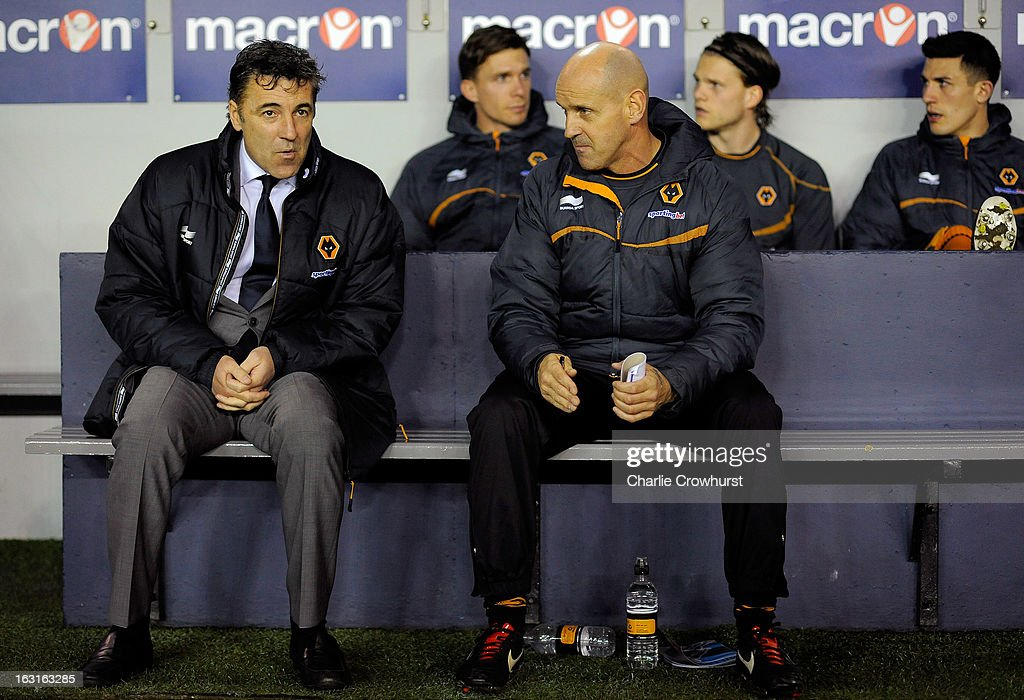 Wolves manager Dean Saunders (L)sits on the bench during the npower Championship match between Millwall and Wolverhampton Wanderers at The Den on March 05, 2013 in London, England,