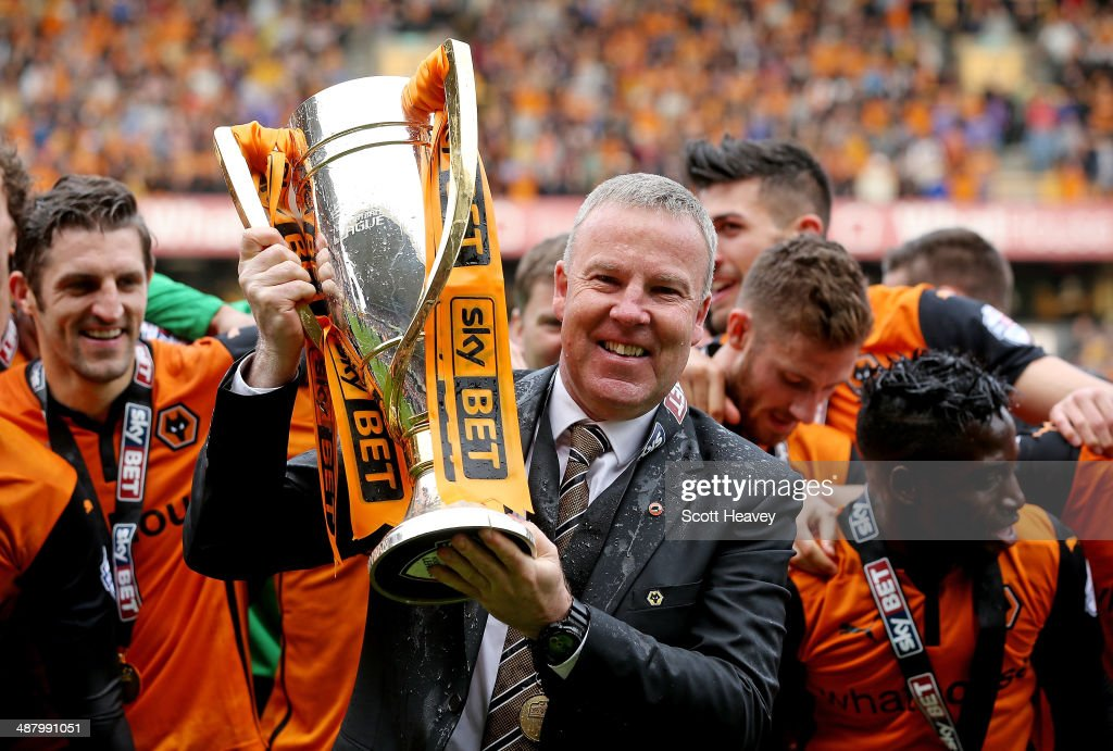 Wolves manager Kenny Jackett lifts the Sky Bet League One trophy during the Sky Bet League One match between Wolverhampton Wanderers and Carlisle United at Molineux on May 3, 2014 in Wolverhampton, England.