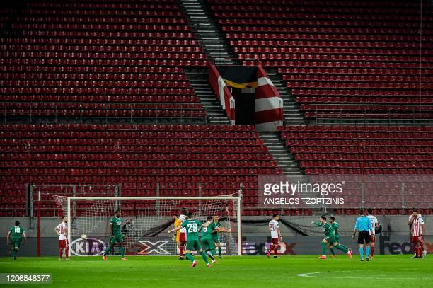 Wolves Pedro Neto celebrates with teammates after scoring during the UEFA Europa League first leg of roundof16 football match between Olympiakos FC...
