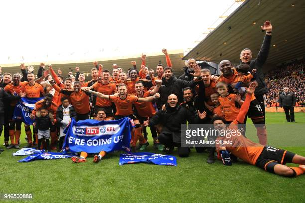 Wolves players celebrate promotion during the Sky Bet Championship match between Wolverhampton Wanderers and Birmingham City at Molineux on April 15...