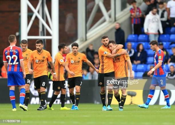 Wolves players celebrate their late equaliser during the Premier League match between Crystal Palace and Wolverhampton Wanderers at Selhurst Park on...