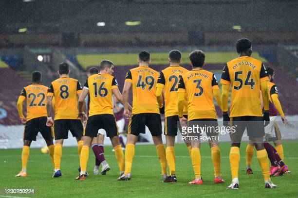 Wolves' players line up to defend a freekick during the English Premier League football match between Burnley and Wolverhampton Wanderers at Turf...