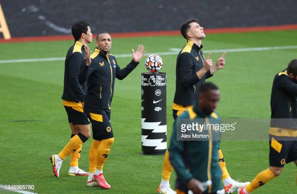 Wolves players walk out past the match ball plinth during the Premier League match between Aston Villa and Wolverhampton Wanderers at Villa Park on...