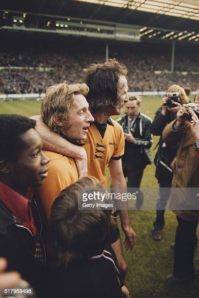 Wolves striker Derek Dougan embraces Manchester City striker Denis Law after the 1974 League Cup Final between Wolverhampton Wanderers and Manchester...